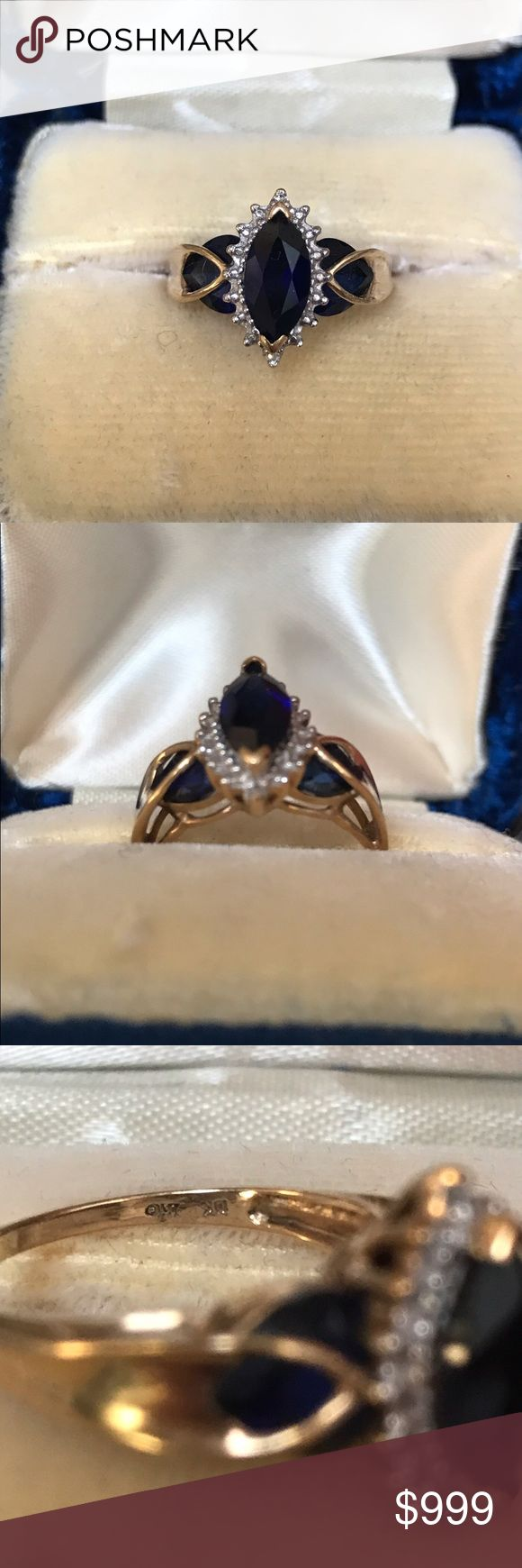10kt YELLOW GOLD SAPPHIRE AND DIAMOND RING GORGEOUS DIAMOND AND BLUE SAPPHIRE RING SET IN 10kt YELLOW GOLD..ROUND DIAMONDS SURROUNDING MARQUIS SHAPED BLUE SAPPHIRE .. TWO ADDITIONAL SAPPHIRES ON SIDES... SIZE 7. BARELY WORN Jewelry Rings
