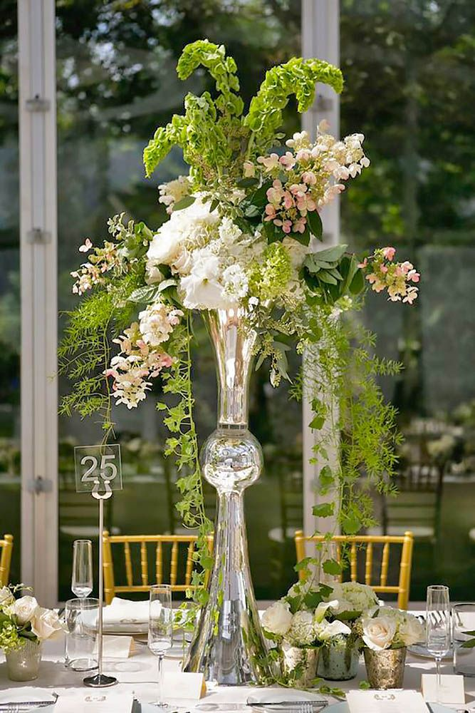 319 best images about over the top tall wedding for Floral arrangements for wedding reception centerpieces