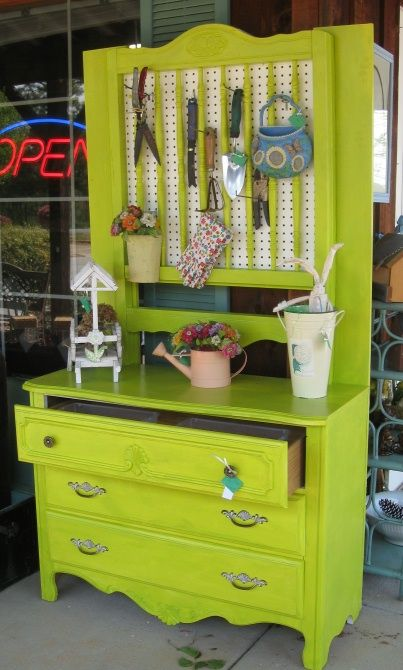 Vintage Dresser Turned Potting Shed.  Good idea for up-cycling something beyond use inside. Using an old desk with side drawers also works well.