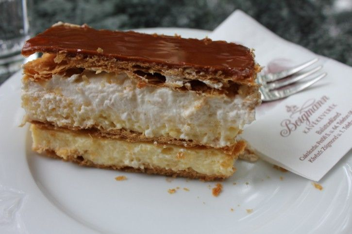 Bergmann's mille-feuille dessert cake. There is vanilla cream and whipped cream between the crunchy, buttery puff pastry layers and the top is glazed with caramel fondant. #Balaton #lake #gastronomy #sweet #cake #confectionery