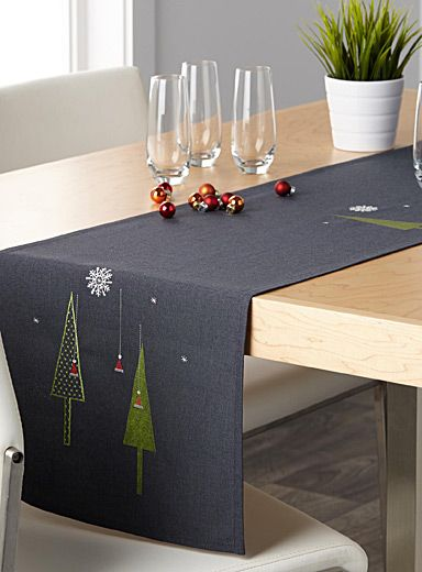 """Exclusively from Simons Maison     Are you celebrating Christmas in your downtown loft? Opt for this modern table runner with minimalist lines and very elegant graphic embroidery on a dark grey weave.    High-quality polyester   Easy-care, machine wash and dry   No-iron fabric that stays beautiful wash after wash   Matching napkins and tablecloth also available   4 sizes available: 14"""" x 54"""", 14"""" x 72"""", 14"""" x 90"""" and 14"""" x 108"""""""