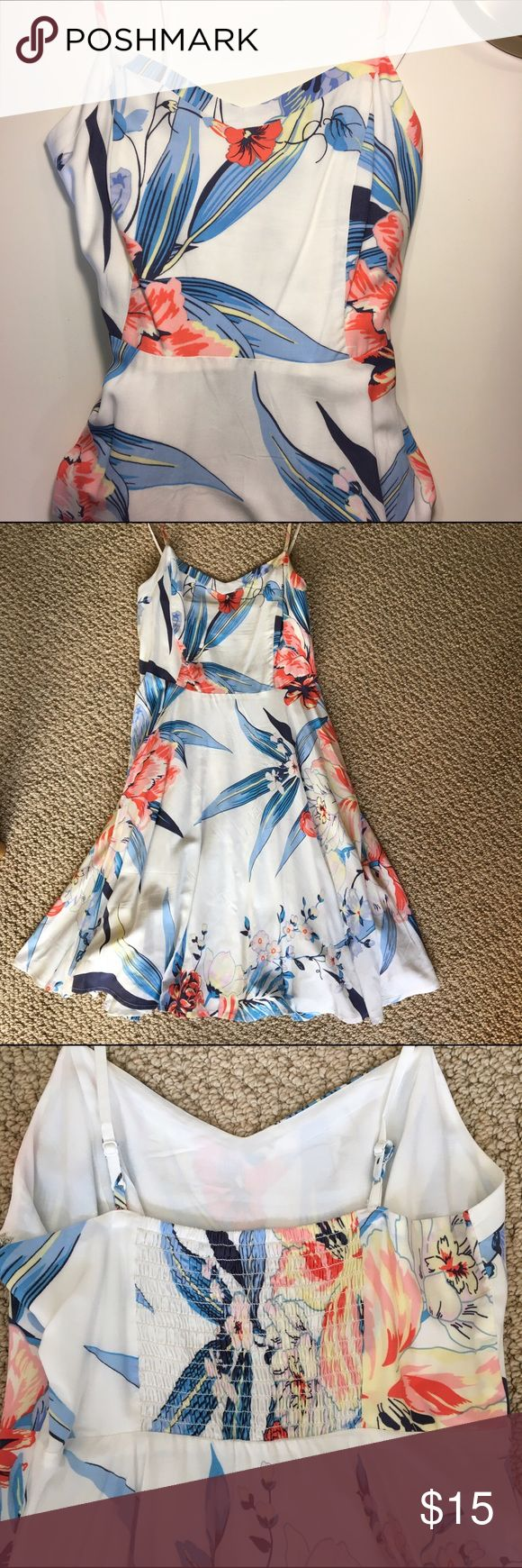 Old Navy floral fit and flare dress Old Navy floral, fit and flare dress in EXCELLENT condition! First photo is of a similar dress, just a different print. Removed tag, but never wore it. It just needs a new home! Features inner lining, adjustable straps and stretch top. Zipper on side. Super flattering fit and flare dress!  Old Navy Dresses