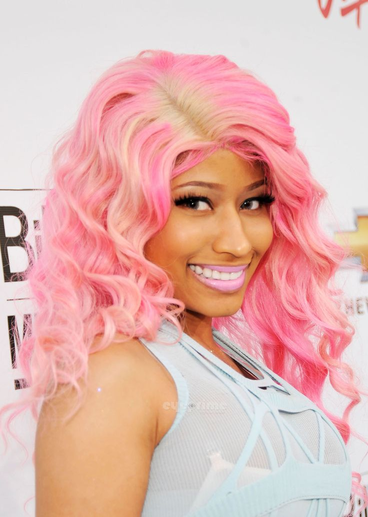 Nicki Manaj hair and makeup:    Very tand and clean. Popped out and wide eyes. Long eyelashes.BIG bright lips.     Very long and bold. Always bright and cute. Always has volume and is super original