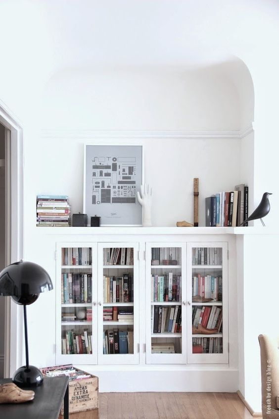 tiny house decorating and storage inspiration -glass front white built-ins: