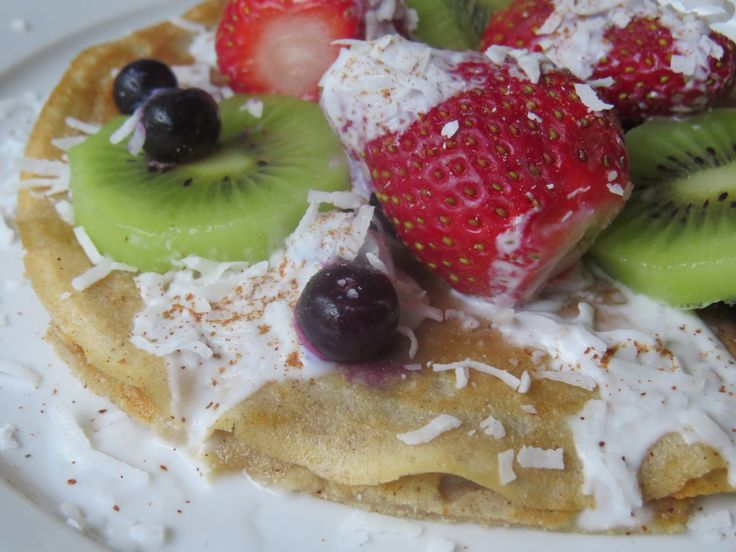 Coconut Pancakes with Greek yoghurt, acai berry blend, roasted almonds, goji berries, vanilla and a touch of Maple Syrup!