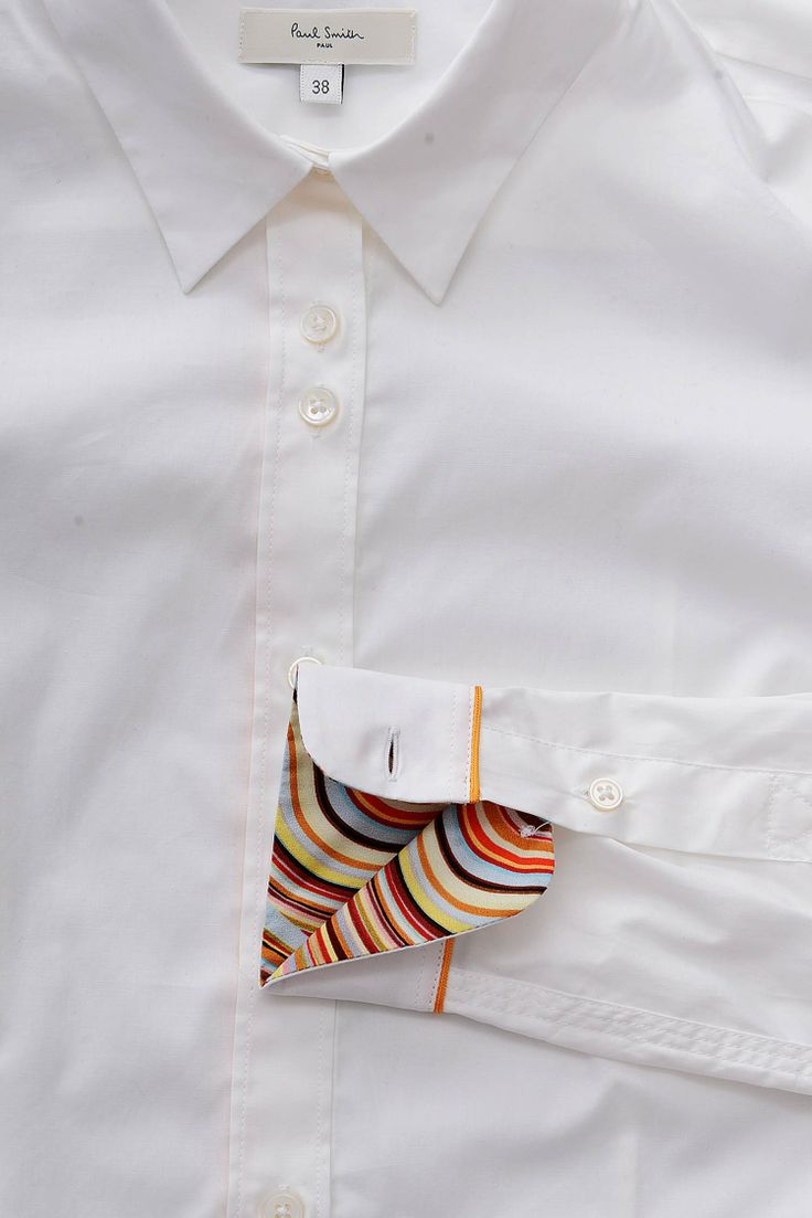 3. Paul Smith's insanely elegant convertible shirt cuffs. Many Paul Smith shirts feature sharply mitered cuffs and a button-cufflink thingy that lets you wear the cuffs two ways. Or even three: you could also roll up the cuffs to reveal their Laura Ashley-on-acid print lining.