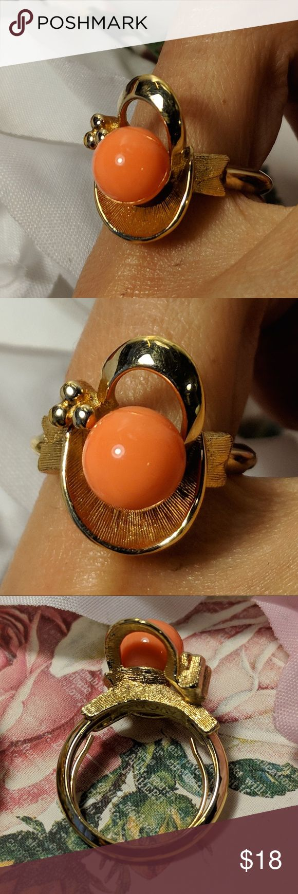 Vintage Avon Peach Orange Gold Cocktail Ring Sz 5 Vintage Avon Peach Orange Gold Cocktail Ring Sz 5  Vintage ring. Marked Avon. Has comfort sizer inside. Size 5 on my sizer. In perfect vintage condition. Looks new. Face is approx. 5/8 of an inch long. Stone is glass or lucite. Avon Jewelry Rings