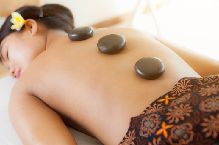 How do you start your day? We recommend with our  hot stone massage at Black Sands Spa.