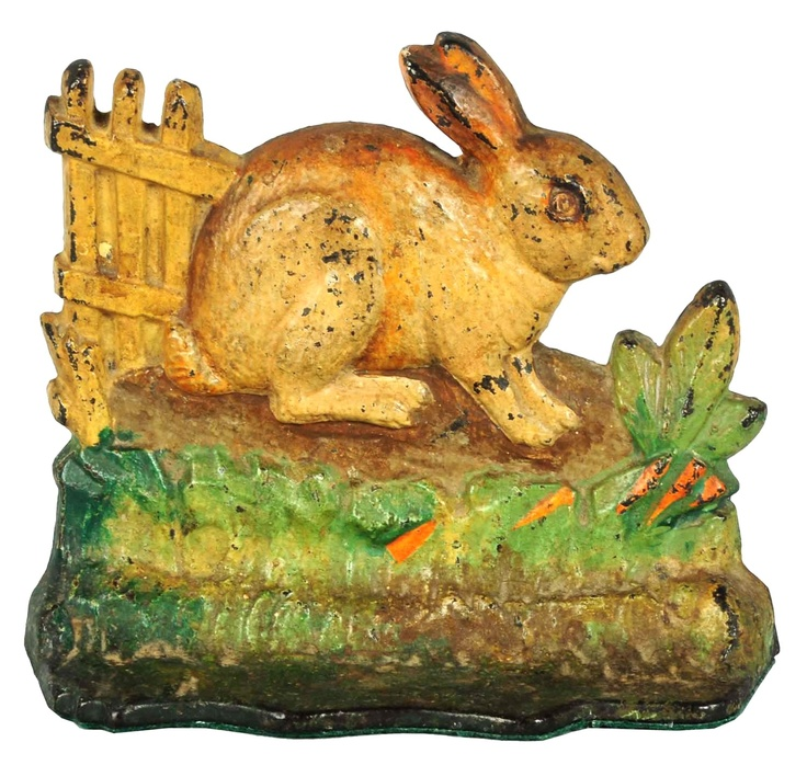 April 19 & 20 Auction. Cast Iron Rabbit By Fence Doorstop. Depicts a rabbit in a garden with carrots and a picket fence in the background. Albany Fdry Co.