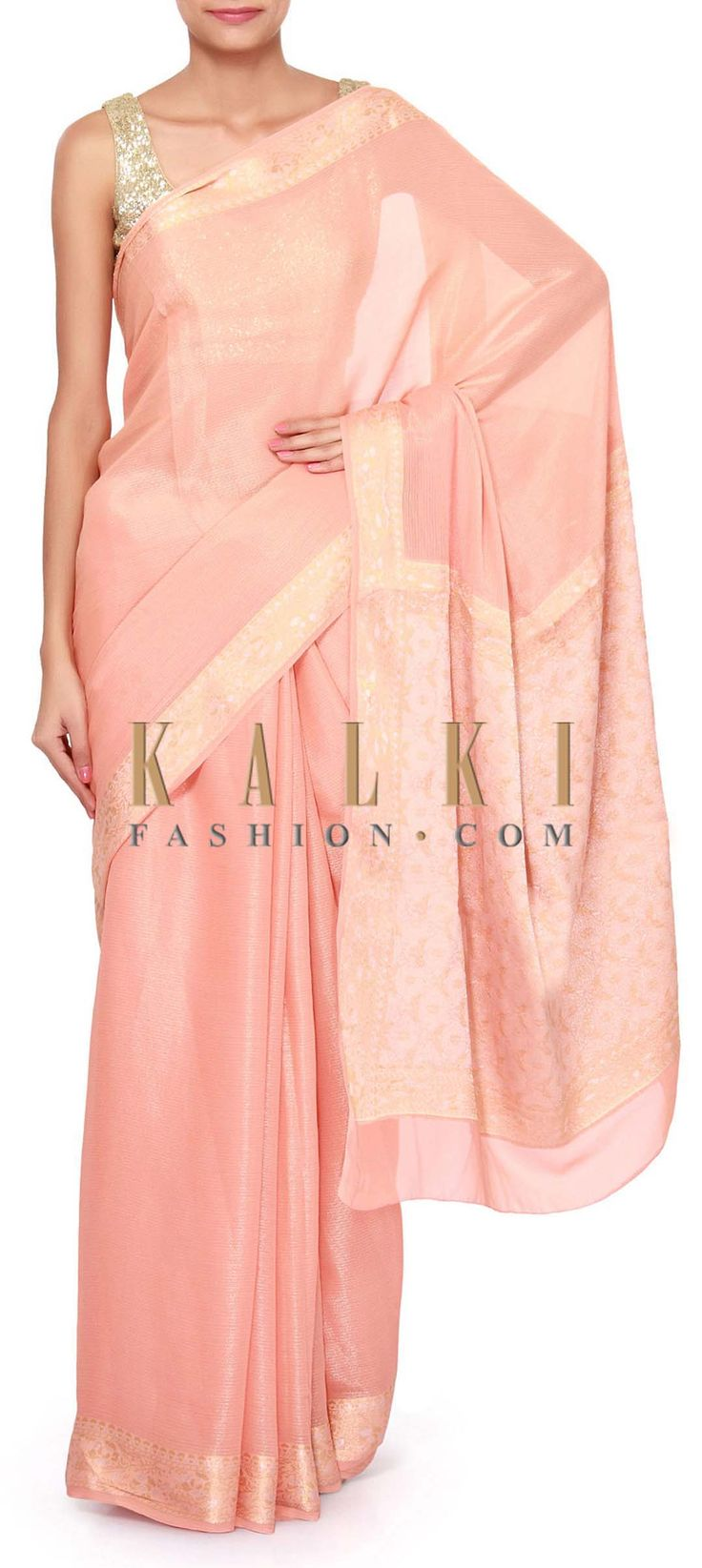 Buy Online from the link below. We ship worldwide (Free Shipping over US$100). Product SKU - 305409.Product Link - http://www.kalkifashion.com/peach-saree-enhanced-in-weave-embroidery-only-on-kalki.html