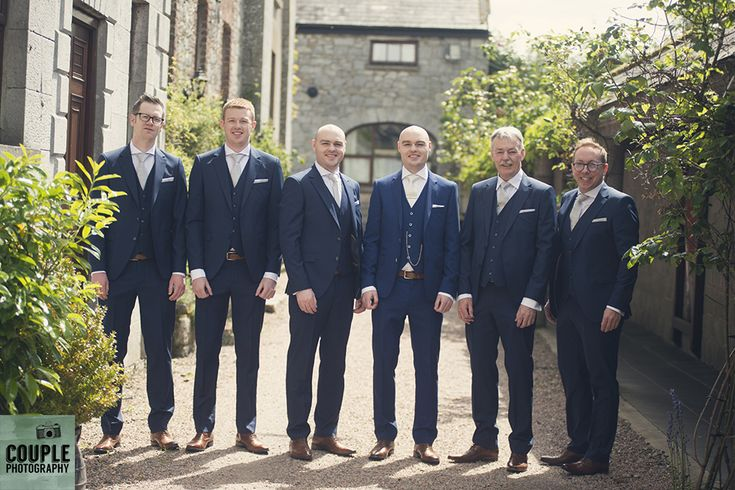 The groomsmen in the sun about to head from Cabra to the church ceremony. Weddings at Cabra Castle photographed by Couple Photography.