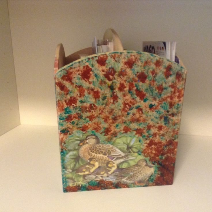 Decoupaged magazine rack , second side