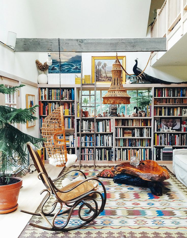 Bohemian patterned library / living room with an indoor swing
