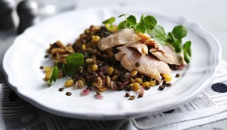 A smoked trout salad with puy lentils, yellow peas and crushed walnuts