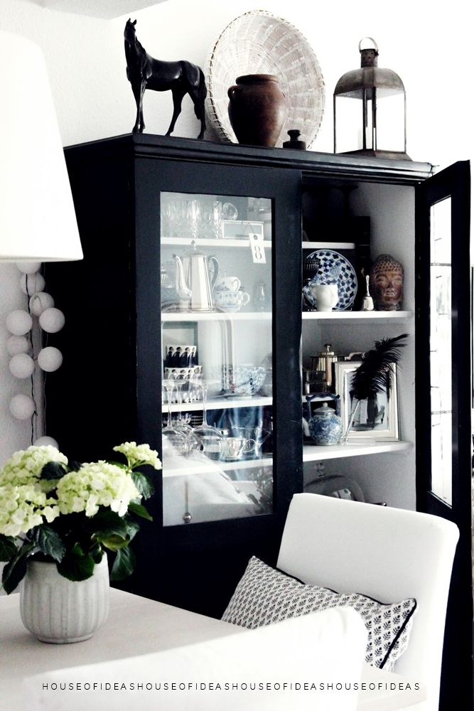 black glass front cabinet with white interior