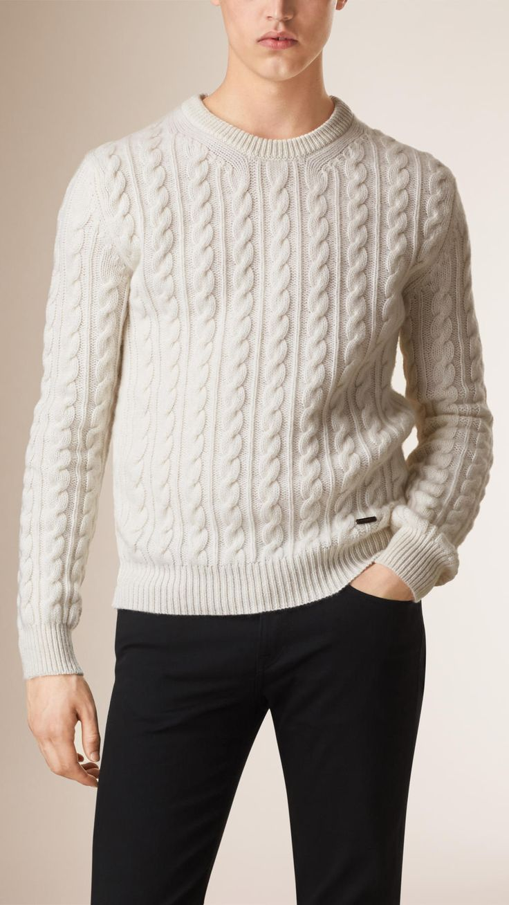 A cable knit sweater made from Scottish-spun lambswool and cashmere. Knitted on traditional machines in the UK and twisted by hand using a special lifting and crossing technique, it takes up to one day to create the finished garment. The sweater is washed in Welsh water for a uniquely soft finish.