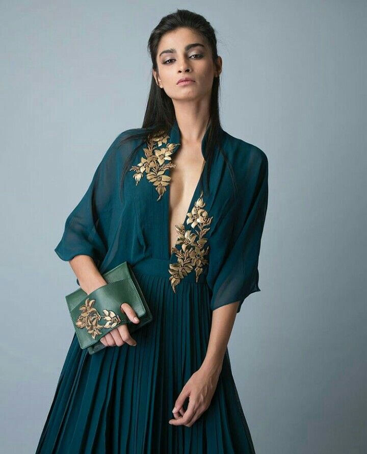 Ridhi Mehra-Emerald green gown with leather and metallic embellished motifs paired with embroidered leather clutch