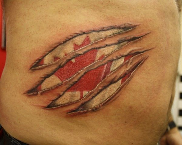 Canadian flag under skin rip tattoo