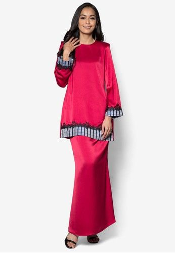 Baju Kurung Modern from Gene Martino in Red Gene Martino wants to make sure you look good when the occasion calls for traditional wear. Simple and feminine, this loose-fitting check trimmed design does so much for you with so little. A good purchase, we must say. Top - Polyester - Rou... #bajukurung #bajukurungmoden