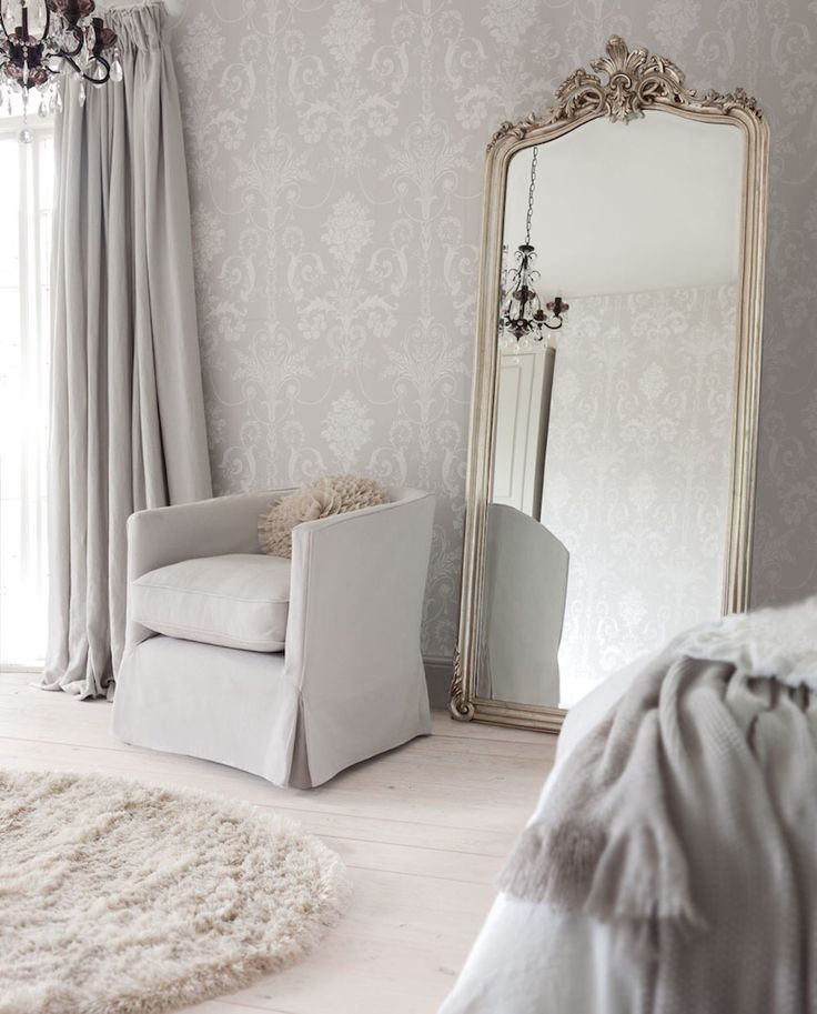 Light grey room with large floor mirror | Grey and white decor is stunning in this bedroom. The room could not be complete without the large gilt floor mirror. ➤ Discover the season's newest designs and inspirations. Visit us at http://www.wallmirrors.eu #wallmirrors #wallmirrorideas #uniquemirrors @WallMirrorsBlog