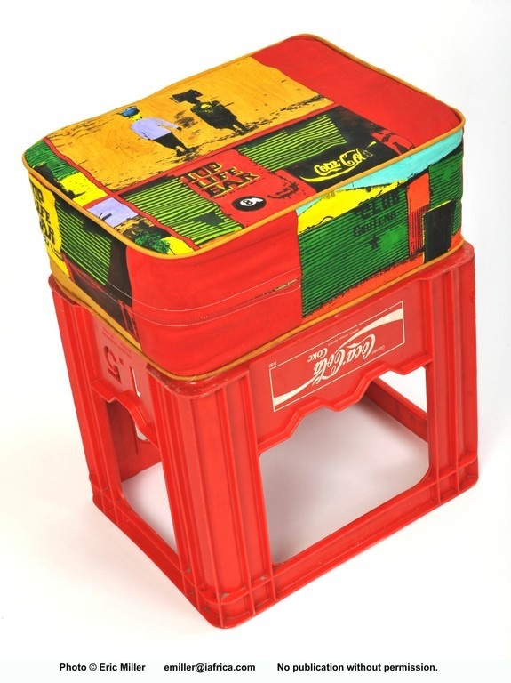 upcycled crate seat. Maid in Africa. Hand painted textile cushion and cola crate seat.