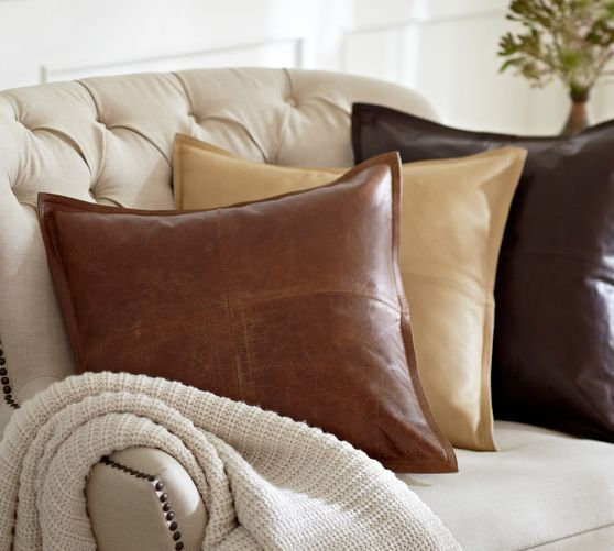 "Pieced leather pillow cover The highest quality of American workmanship is evident in this pillow's authentic leather patchwork. As with all leather, it only gets better with age. 20"" square Leather front reverses to pure linen. Insert sold separately; down blend or synthetic. Dry-clean."