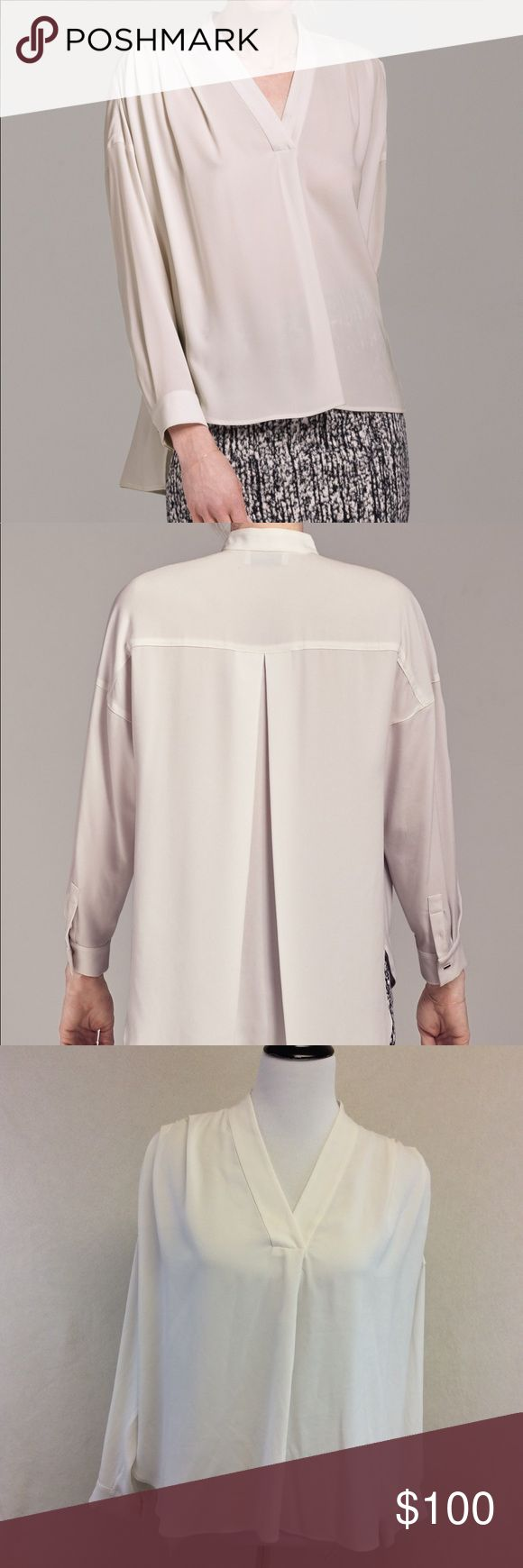 "M MM LAFLEUR white Morrison shirt Brand: M.M. Lafleur Style: Morrison shirt  Size: medium  Approximate Measurements: pit to pit 26.5"" shoulder to hem 24""-27"" Material: 80% cellulose acetate 20% polyester Features: hi lo hem, pleated shoulders, long cuff sleeves, v neck Condition: excellent condition MM Lafleur Tops Blouses"
