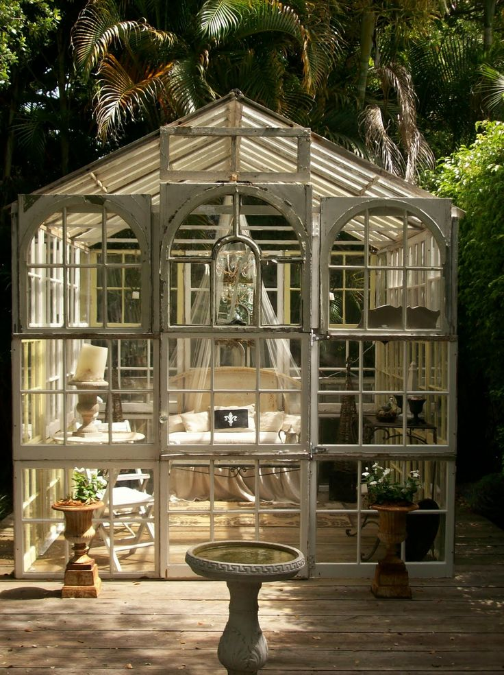 Started collecting the windows and doors....I'm going to build one that attaches to the ugly plastic shed.  Potting area in the front and storage in the back. Salvaged window glass house w/ deck base