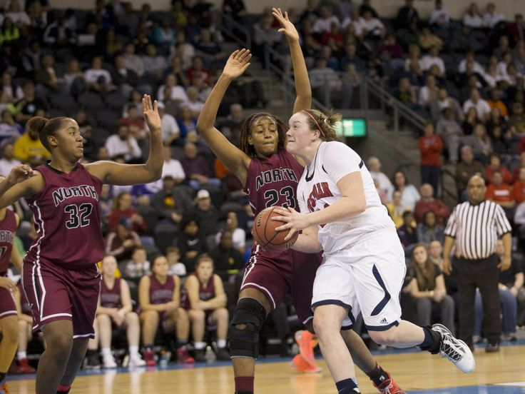Lee's Summit North sisters Imani, left, and Aaliyah Johnson, center, harass Truman center Becca Jonas in Wednesday's Class 5 sectional playoff at the Independence Events Center. The sisters helped the Broncos to a 55-53 win and a berth in Saturday's state quarterfinal game against North Kansas City. Brian Davidson | Special to The Examiner