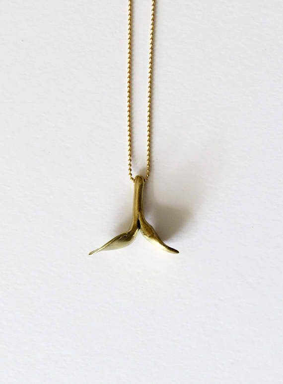 Made from gold plated brass with the lost wax method, represents a minimalistic couple of leaves. Ideal to be combined with another flower pendant. I love sculpting directly in wax and finishing every piece by hand. Its finishing is matte. This pendant is unique and I will not reproduce it, so you will receive a unique piece.   My inspiration is again nature and how delicately everything is growing!   Its dimensions are 2.5 cm in length and 2.5 cm in width. Its chain is a delicate sterling…