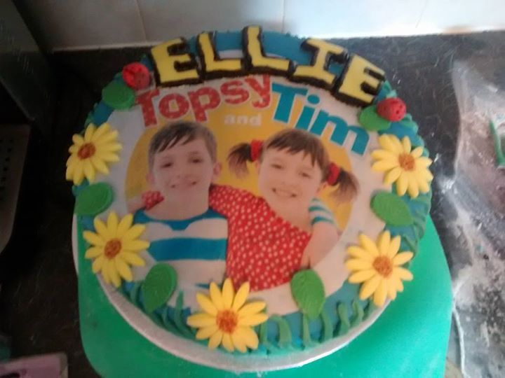 Lovely birthday cake featuring the lovely CBeebies siblings, Topsy and Tim.