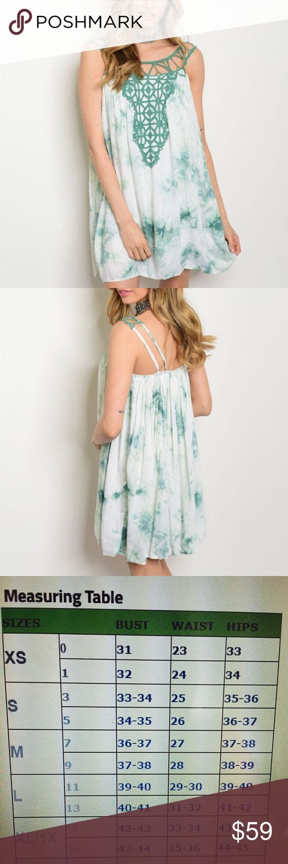 Adorable Jade Tie Dye Crochet Dress This dress is the perfect flattering silhouette dress, which can be paired with your favorite accessories. Beautiful scoop neck. Crochet detail. 100% rayon. Get if before it's gone! amandine boutique Dresses