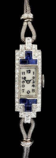"""Art Deco Lady's Platinum, Diamond, and Sapphire Dress Watch the white dial with raised blue enamel hour markers and signed Swiss Made to dial, completed with a platinum mesh band accented with (6) single cut diamonds ) and with fold over adjustable clasp, works marked """"Swiss Made / 15 jewels / 5/320"""""""
