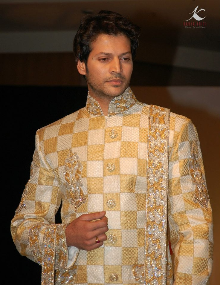 Gold and Silver patch work on Brocade Sherwani with intricately designed buttons and Embellished long Stole.