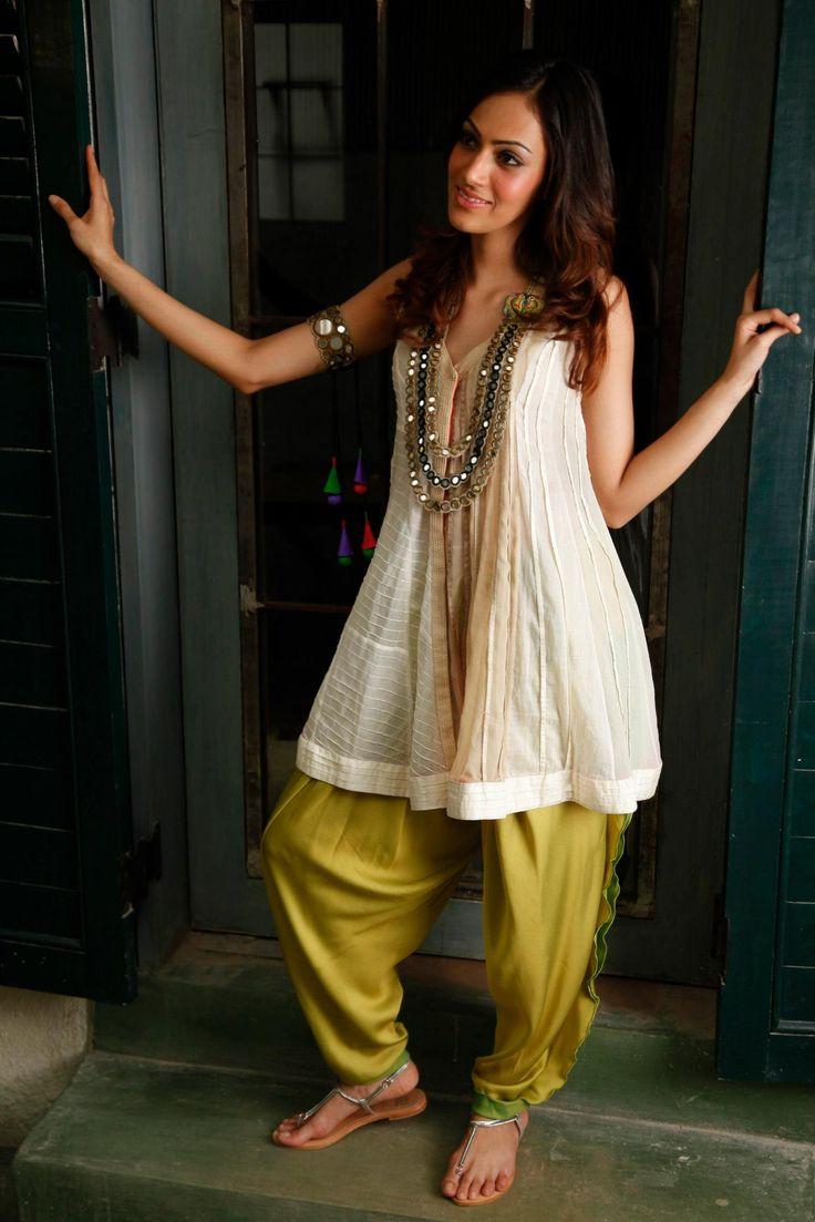 Arpita Mehta. Off white n beige chiffon pleated n pink tucked kurta with a two tone georgette satin salwar