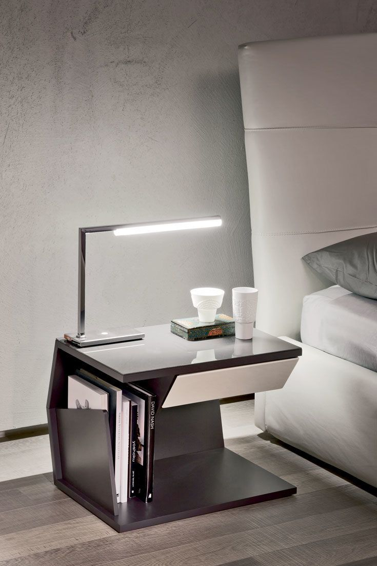 Seven is a floor and table lamp in chromed steel featuring LED light. Designed by Piero De Longhi for Cattelan Italia.