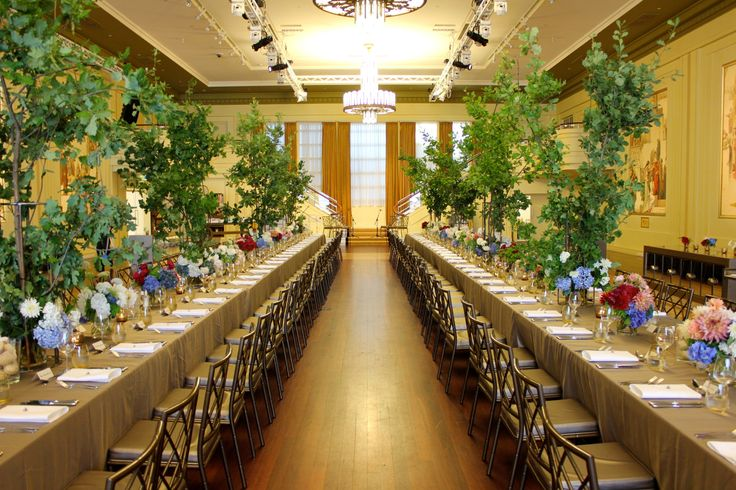 Beautiful dining tables. Oak branches, red white and blue floral.