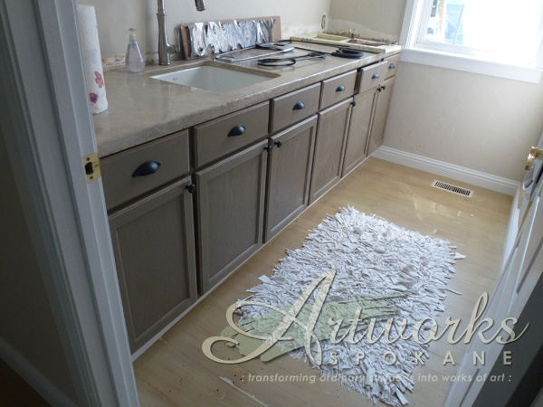 Coco Chalk Paint® decorative paint by Annie Sloan on laundry room cabinets.  #artworksspokane