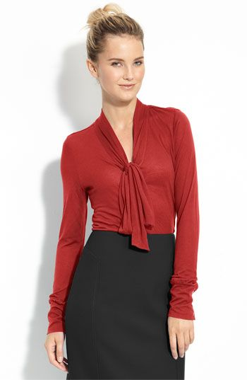 The draping, the sleeves, the button details on the cuff, the warm red color ... great great great!