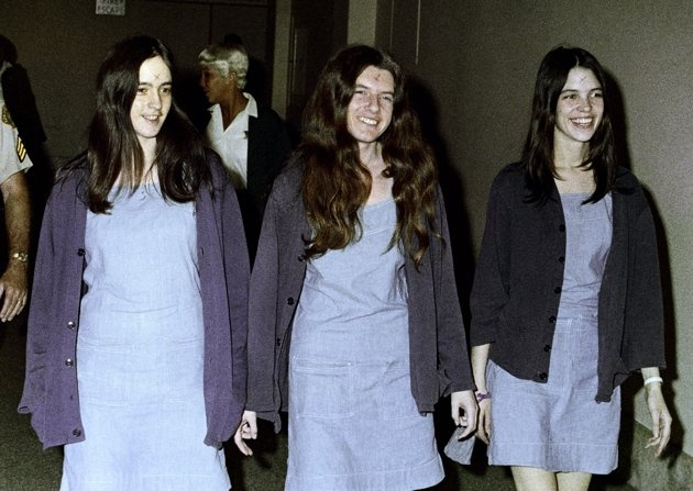 Aug. 1970 file photo, Charles Manson followers, from left: Susan Atkins, Patricia Krenwinkel and Leslie Van Houten walk to court to appear for their roles in the 1969