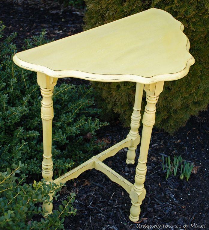 Cute yellow half moon table painted in CeCe Caldwells Carolina Sunshine Yellow