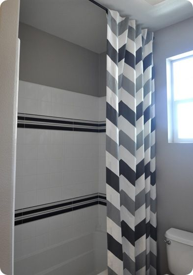 Floor to ceiling shower curtains = instant height to tiny bathroom.