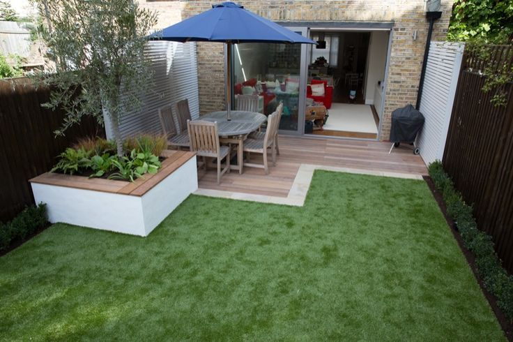 Small garden deck and seating area low maintence grass
