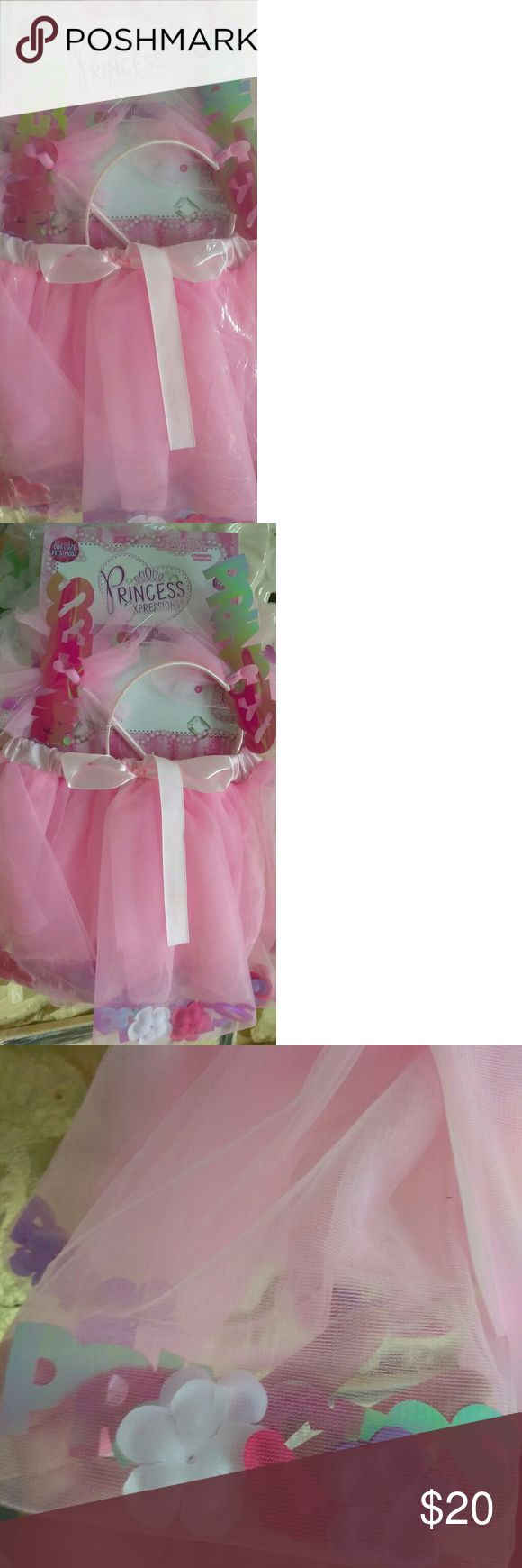 NWT Princess Dress Up Set NWT Princess Dress Up Set. Comes with Pink Tutu with flowers & princess confetti inside, Pink Princess Wand and Pink Princess head band. Brand New never been worn.   One size fits most. See picture with size description. Can be used as a Halloween Costume.   Tutu Material: 100% Polyester Princess Expressions Costumes Dance