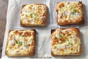 Flammkuchen -  8Toast 1 Becher Creme Fraiche (200g)1 kl Schuss Sahne,1/2 Zwiebel,otional:100 g Schinken, 150 g geriebener Käse,Salz+Pfeffer,Schnittlauch.Backofen 200°C vorheizen. Zwiebel hacken. Creme Fraiche+Schluck Sahne rühren,Zwiebel+ Käse unterheben.Salz,Pfeffer.15 Min. backen