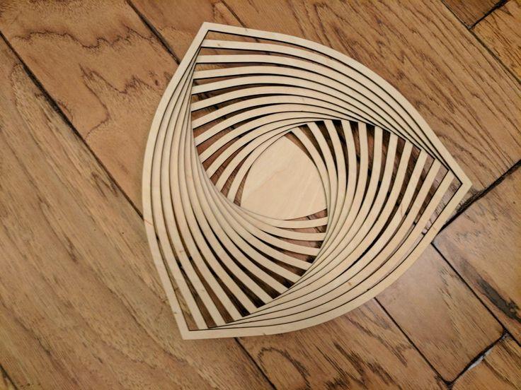 Laser cut spiral wooden bowl.