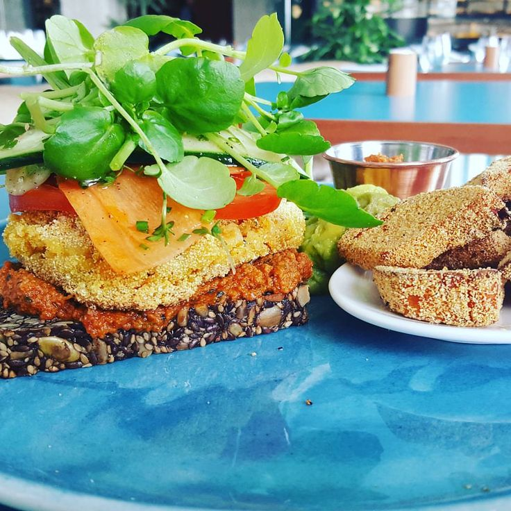 Carrot and Zucchini Burger with tomato pesto, avocado puree, tomatoes with sweet potatoes croutons.