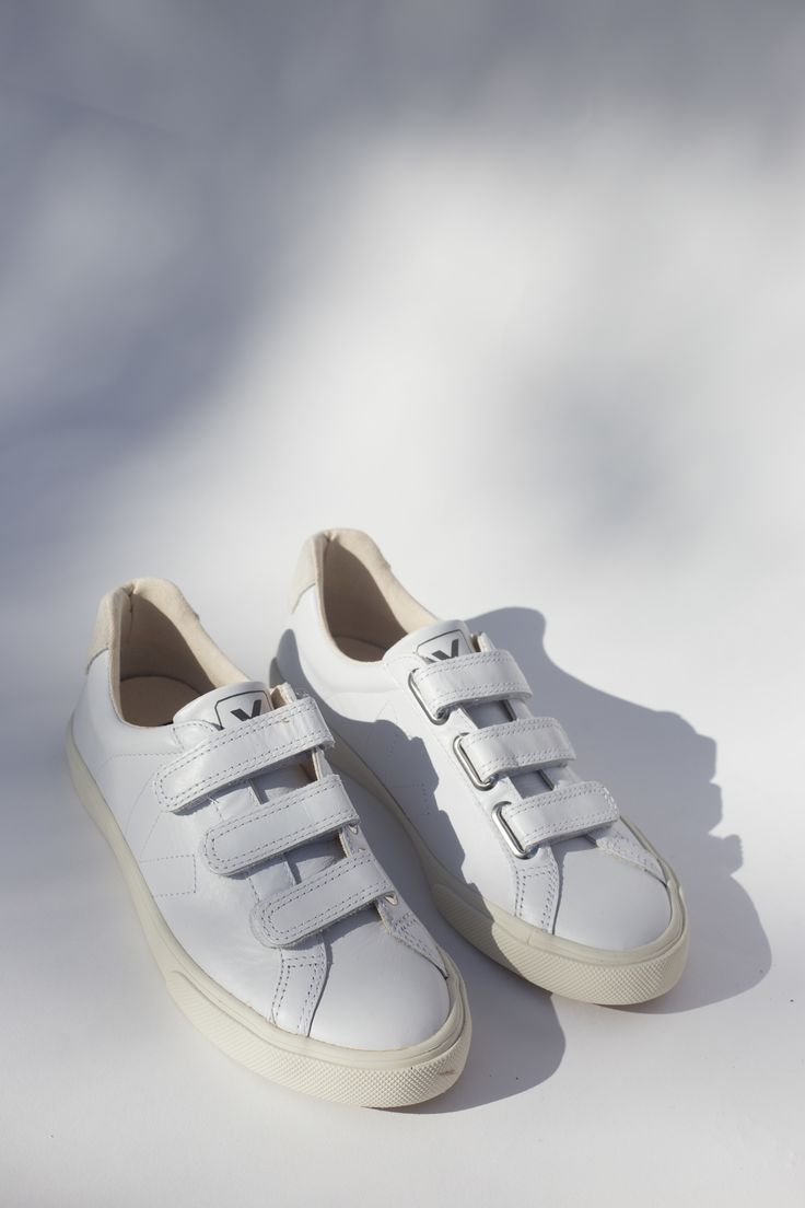 Elegant, easy and environmentally friendly, these kicks are perfect for the  urban walker committed to looking cute on the commute. Velcro closure with  smooth, white leather body and cream stitching and suede detail. By Veja.   These kicks are named after a Brazilian NGO, which brings technical  support to Northern Brazilian organic cotton farming families Veja works  with.    Upper in low-chrome leather. Inner Sole in recycled cotton and expensed  rubber. Sole made of wild rubber from the…