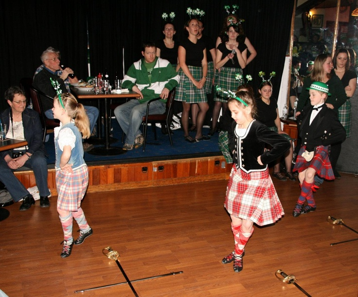 In the background - kilts with non-traditional tops #Breton #Green #Tartan