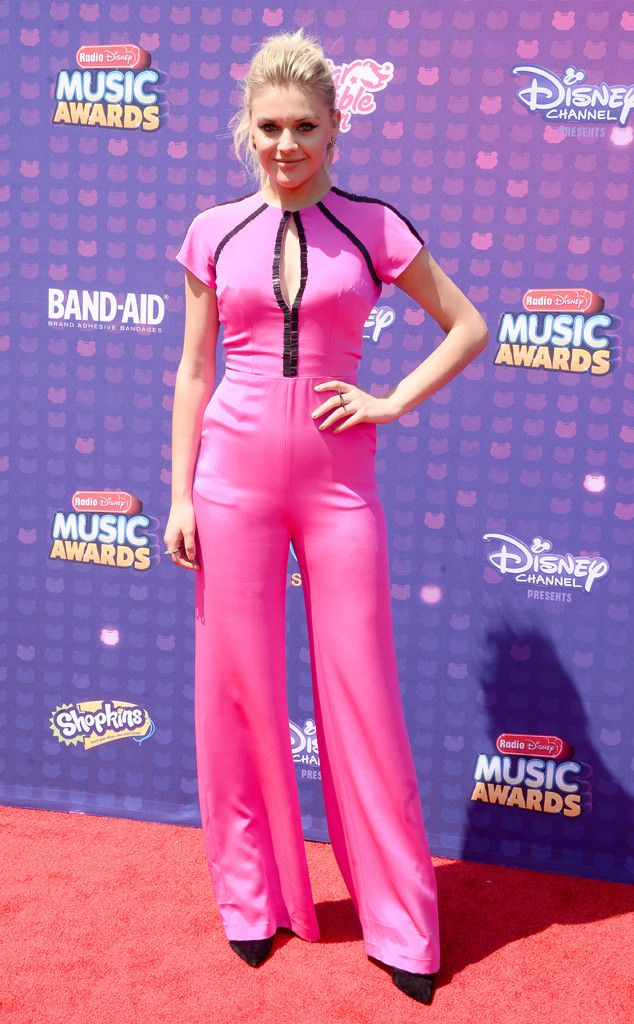 Kelsea Ballerini from Radio Disney Music Awards 2016 Red Carpet Arrivals  Pretty in pink! The country singer shines bright in a jumpsuit before meeting up with Fifth Harmony inside.
